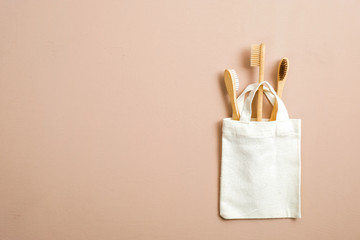 Eco friendly natural bamboo toothbrushes in fabric canvas shopping bag. Zero waste, plastic free...