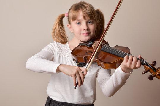 Girl happy looking straight ahead playing violin