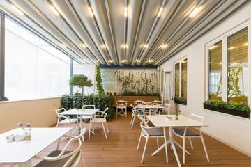 Hotel restaurant terrace interior with heater