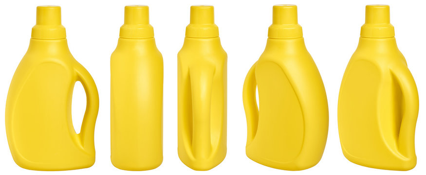 yellow detergent plastic bottle with measuring cap and cleaning liquid isolated on white