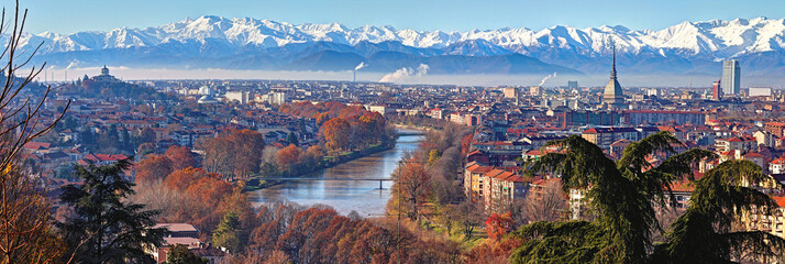 Printed kitchen splashbacks Cappuccino Aerial panoramic winter view on Turin city center with Mole Antonelliana, modern skyscrapers and other buildings, clear blue sky morning with Alps full of snow on background