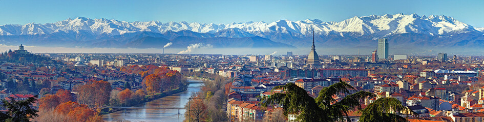 Aerial panoramic winter view on Turin city center with Mole Antonelliana, modern skyscrapers and...