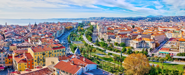 Wall Murals Nice Nice, France - December 1, 2019: Colorful aerial panoramic view over the old town, with the famous Massena square and the Promenade du Paillon, from the roof of Saint Francis tower