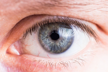 Tuinposter Iris Eye of the person close up