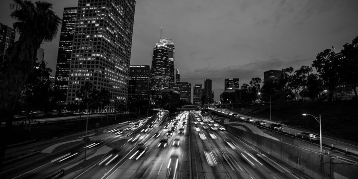 JANUARY 20, 2019, LOS ANGELES, CA, USA - California 110 South leads to downtown Los Angeles with streaked car lights at sunset