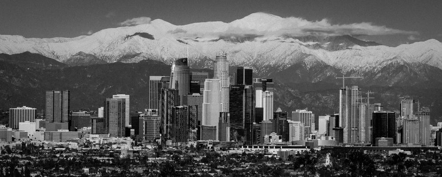"""FEBRUARY 6, 2019 - LOS ANGELES, CA, USA - """"City of Angeles"""" - Los Angeles Skyline framed by San Bernadino Mountains and Mount Baldy with fresh snow from Kenneth Hahn State Park"""