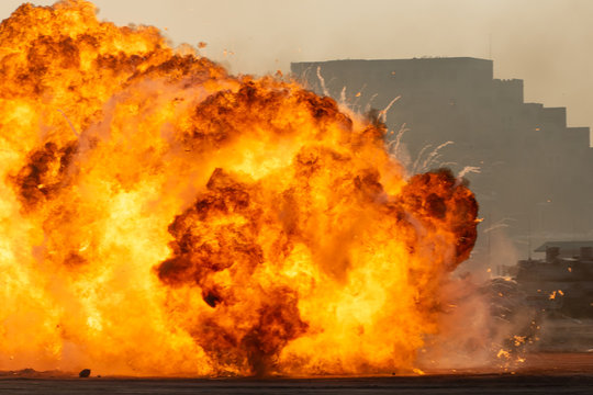 Massive fire explosion or strike in military combat and war. Vehicle explosure from a tank in a city in the Middle East. Military Concept. Strength, power, explosion.