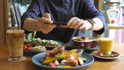 Technology, Social Media And Food Trends. Photographing Food In Restaurant.