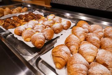 Tasty croissants with cream. Cream croissant. cornetto soft and sweet cream. cream brioche