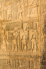 Ruins and Hieroglyphs in the famous Temple of Kom Ombo in Egypt on nile river bank