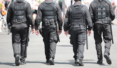 Keuken foto achterwand Venetie Four cops with uniform