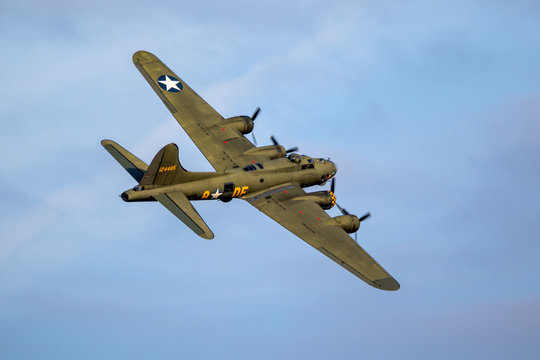 SANICOLE, BELGIUM - SEP 13, 2019: Vintage warbird US Air Force Boeing B-17 Flying Fortress WW2 bomber plane perforing at the Sanice Sunset Airshow.