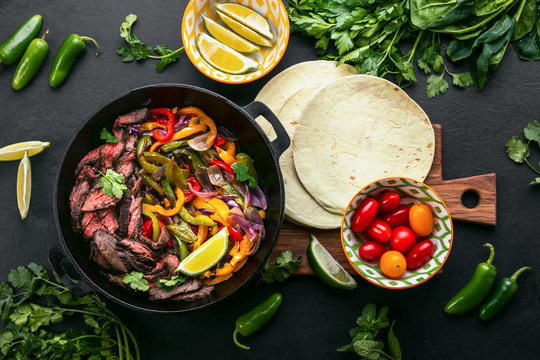 Grilled skirt steak and stir fried vegetables fajitas, top down view