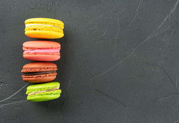 Spoed Foto op Canvas Macarons Four multicolored macaroons