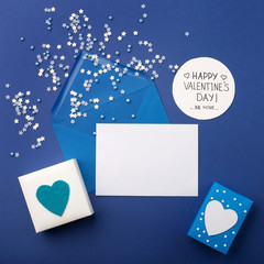 Blue envelop, gifts and white hearts on classic blue