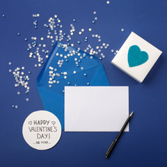 Empty card with blue envelope, little stars and heart.
