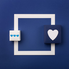 Happy Valentine's Day card with gifts and white heart on classic blue