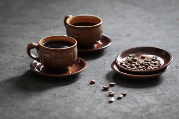 Poster Cafe Still life black coffee in a Cup with coffee beans on a dark background
