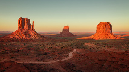 Sunset in the famous Monument Valley, on the border between Arizona and Utah. Navajo tribal park