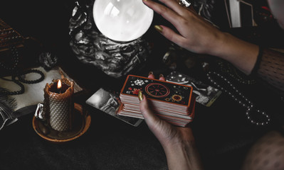 Magical scene, esoteric concept, fortune telling, tarot cards on a table