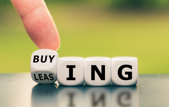 "Hand turns a dice and changes the word ""leasing"" to ""buying"", or vice versa."
