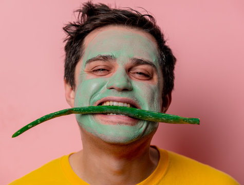 beautiful brunette man with aloe mask on his face