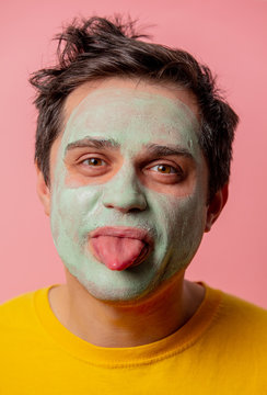 beautiful brunette man with algae mask on his face