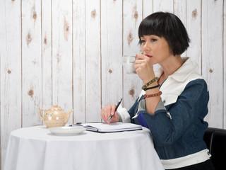 Woman having coffee alone
