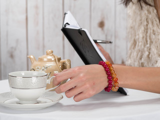 Woman hand coffee with bracelet