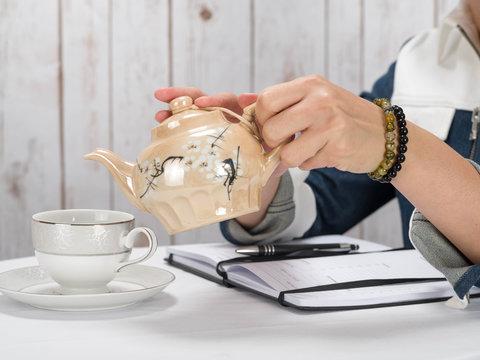 Woman pouring tea bracelet