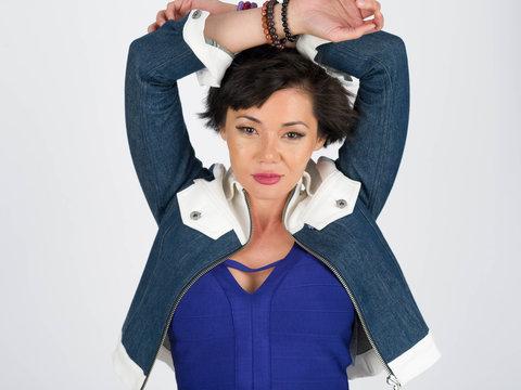 Woman blue jacket arms up - Acela Kuandykova