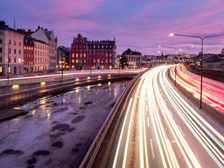 Foto auf Leinwand Stockholm The evening traffic creates light streaks in central Stockholm