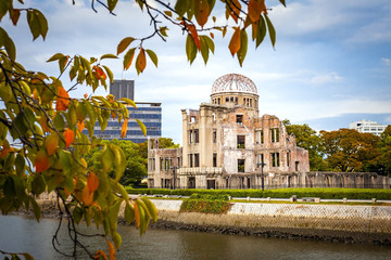 Hiroshima, Japan - October 2 2019: The ruins of the Hiroshima atomic bomb dome on an Autumn evening. Now listed as a World Heritage site to communicate the devastation caused by nuclear weapons.