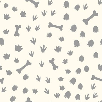 Allover seamless repeat pattern with different shape gray dinosaur tracks and bones tossed on an ivory background