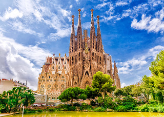Tuinposter Barcelona BARCELONA, SPAIN - SEPTEMBER 15,2015 : Sagrada Familia in Barcelona. Sagrada - the most known the buildings created by Antoni Gaudi.
