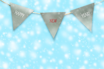 Triangular flags on a rope. Blue background. Christmas background.