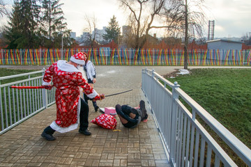Foto op Plexiglas Asia land a thematic series of photos Xmas X-mas No More a group of beautiful hooligans meets Santa turning him into a Zombie