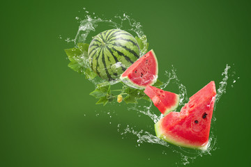 Fototapeta Water splashing on Sliced of watermelon on green background obraz