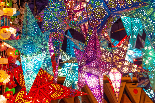 Paper bright multi-colored Christmas and New Year stars decorations.