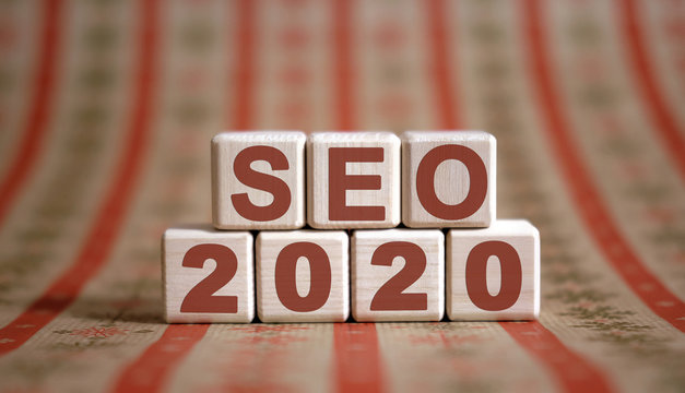 Seo 2020 concept. Wooden cubes on a print background