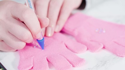 Wall Mural - Rhinestone pink kids gloves with snowflake shapes.