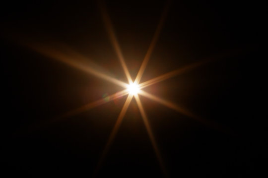 Easy to add lens flare effects for overlay designs or screen blending mode to make high-quality images. Abstract sun burst, digital flare, iridescent glare over black background.