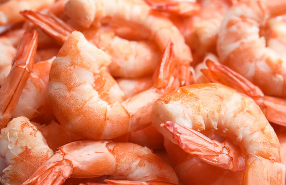 Pile of delicious peeled shrimps as background, closeup