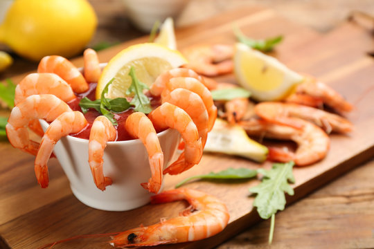 Delicious shrimp cocktail served on board, closeup