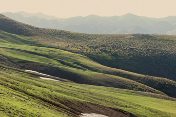 Foto op Canvas Pistache landscape with hills and blue sky