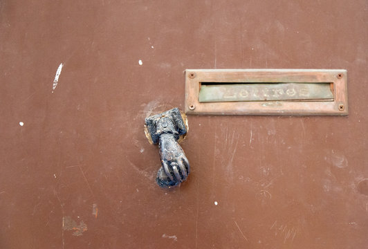 Close up of letter box and metal door knocker in Provence in France.  with French word lettres meaning letters on the flap