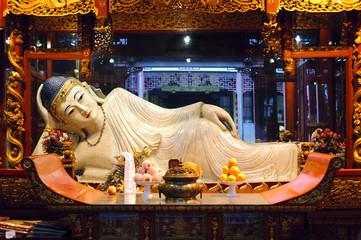 SHANGHAI, CHINA - APRIL 5, 2013 - Reclining Buddha at the Jade Buddha Temple, Shanghai, China