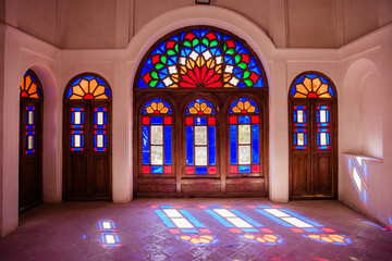 beautiful multi-colored stained-glass windows in the houses and mosques of Iran.