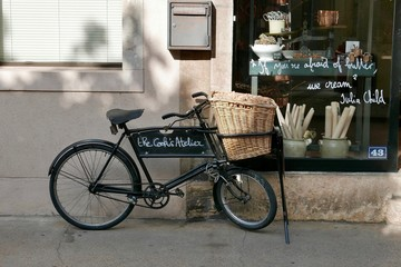 Garden Poster Bicycle traditional delivery bike outside patisserie in Beaune in France