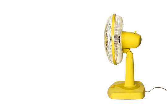 Electric Yellow table fan isolated on white background